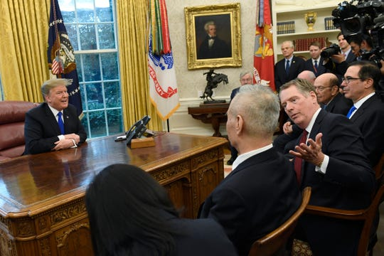 FILE- In this Feb. 22, 2019, file photo President Donald Trump, left, talks at the same time that U.S. Trade Representative Robert Lighthizer, second from right, talks with Chinese Vice Premier Liu He, second from left, during their meeting in the Oval Office of the White House in Washington. The Trump administration and Chinese officials will hold their latest round of talks late this week in Beijing. (AP Photo/Susan Walsh, File)