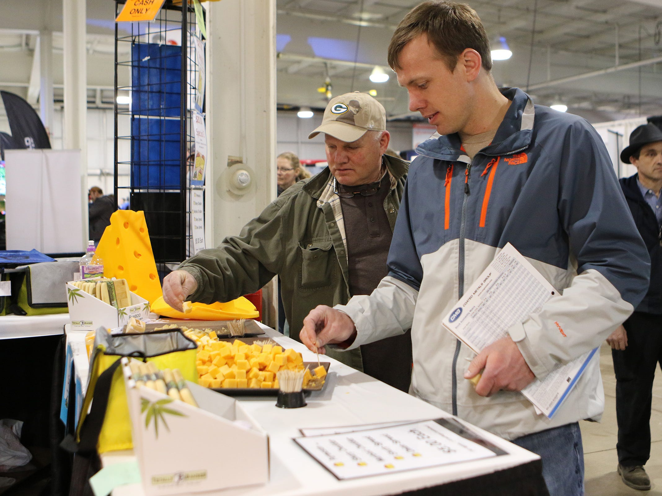 The line for cheese samples at Simon's Specialty Cheese was long but moved quickly at the Wisconsin Public Service Farm Show on March 27.