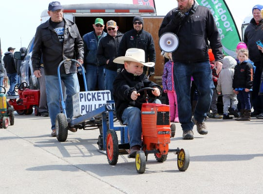 Presley Putzke, 7, of Berlin, takes first place in his group for the Kiddie Tractor Pull at the Wisconsin Public Service Farm Show on March 28 in Oshkosh.