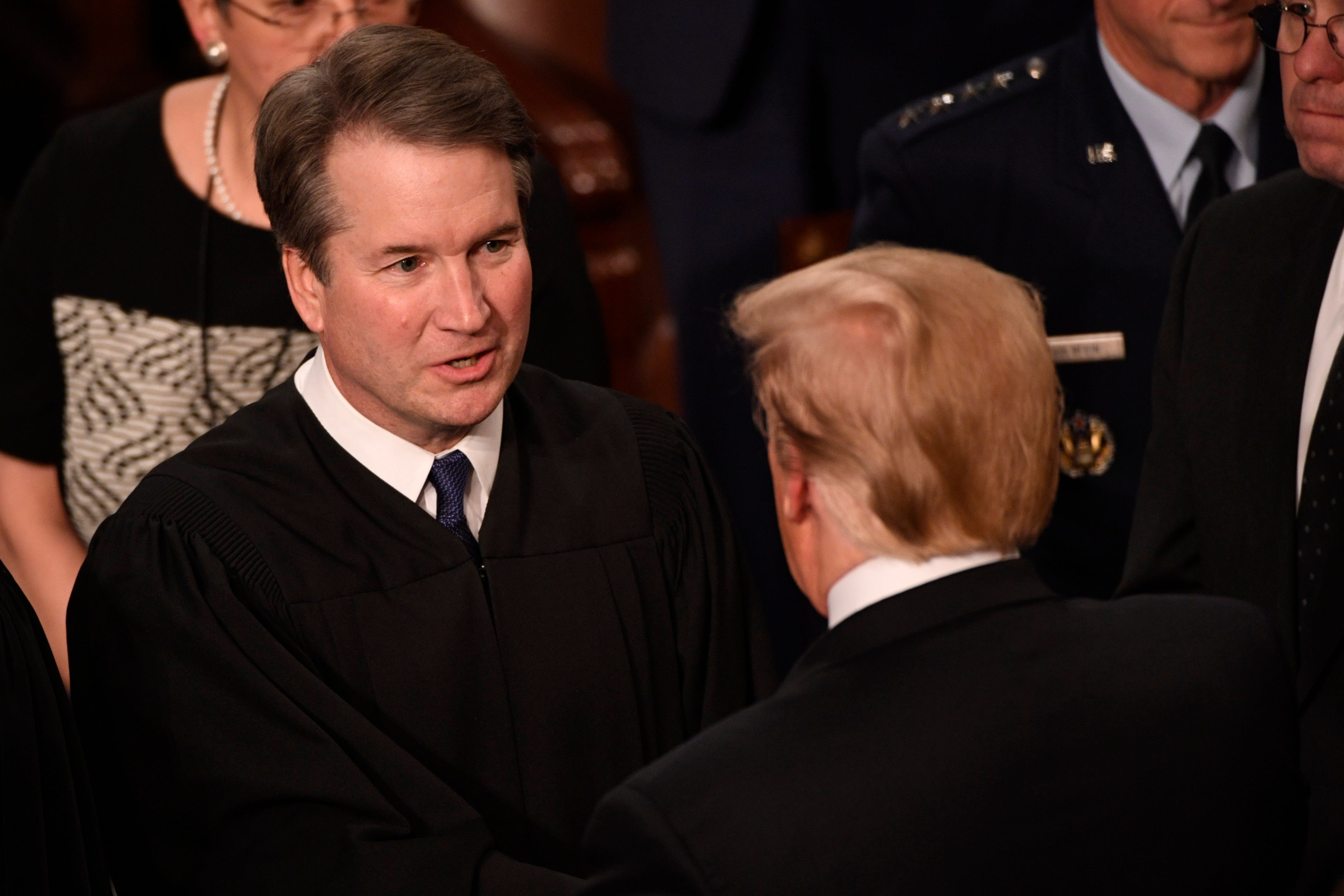 Supreme Court Associate Justice Brett Kavanaugh greets President Donald Trump before the State of the Union address in the House chamber of the United States Capitol in February 2019.