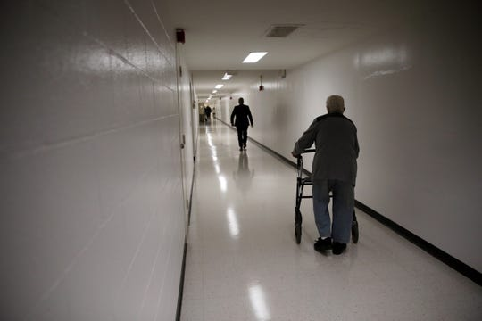 A man passes down a hall at the Edith Nourse Rogers Memorial Veterans Hospital in Bedford, Massachusetts on Nov.  4, 2017.