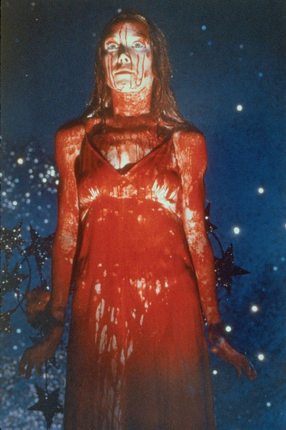"Sissy Spacek's prom queen is covered in blood – and not pleased at all – in ""Carrie."""