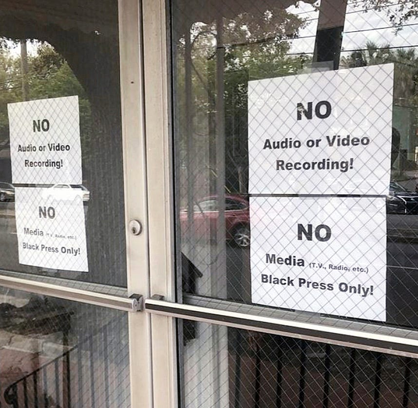 In this Wednesday, March 27, 2019 photo, signs posted on the doors of the Bolton Street Baptist Church are seen during a meeting coordinated to garner support for one black candidate in Savannah's mayoral race, in Savannah, Ga.