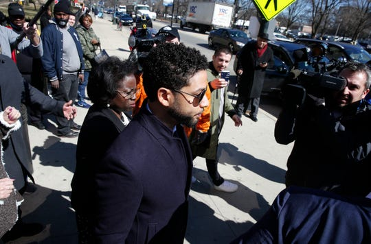 Actor Jussie Smollett leaves after his court appearance at Leighton Courthouse on March 26, 2019, in Chicago.