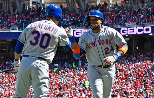 Mets second baseman Robinson Cano is congratulated by Michael Conforto after his home run in the first inning agaisnt teh Nationals.