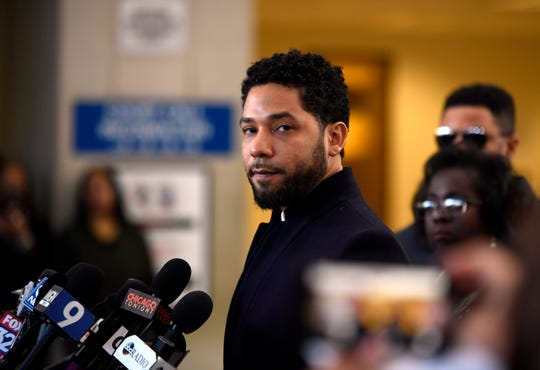 Actor Jussie Smollett talks to the media before leaving Cook County Court after his charges ended Tuesday, March 26, 2019, in Chicago.