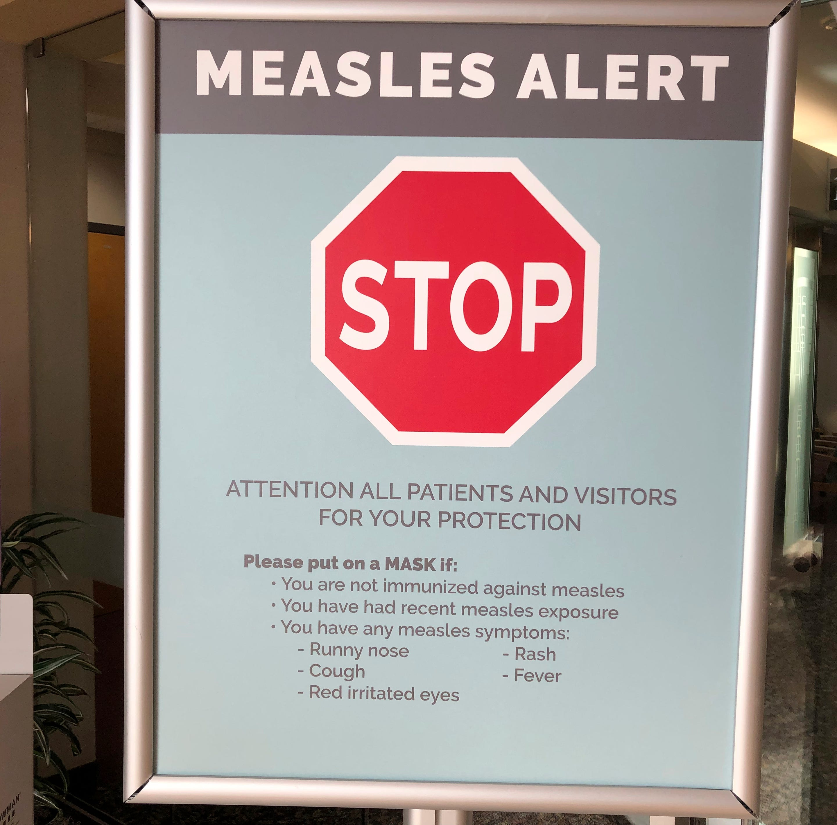 In this Jan. 30, 2019, file photo, a sign posted at The Vancouver Clinic in Vancouver, Wash., warns patients and visitors of a measles outbreak. The focus on measles in the Pacific Northwest intensified Friday, March 1, 2019, as public health officials in Oregon announced a new case of the highly contagious disease unrelated to an ongoing outbreak in Washington state that's sickened 68 people so far.