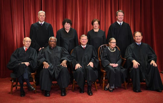 The formal 2018 portrait of the Supreme Court of the United States. Seated from left: Associate Justice Stephen Breyer, Associate Justice Clarence Thomas, Chief Justice of the United States John G. Roberts, Associate Justice Ruth Bader Ginsburg and Associate Justice Samuel Alito, Jr. Standing behind from left: Associate Justice Neil Gorsuch, Associate Justice Sonia Sotomayor, Associate Justice Elena Kagan and Associate Justice Brett M. Kavanaugh.