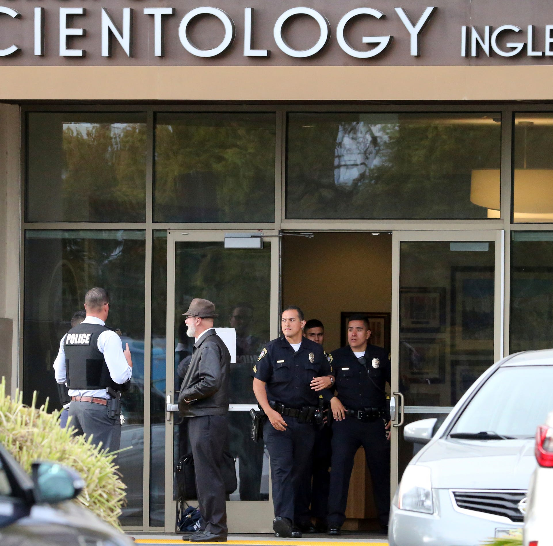 Man with sword fatally shot at Scientology church, two California officers injured