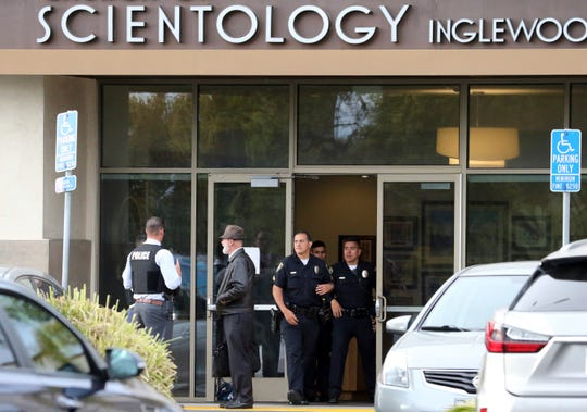 """Police stand outside and investigators work at the entrance of the Church of Scientology in Inglewood, California on Wednesday. """"Width ="""" 540 """"data-mycapture-src ="""" """"data-mycapture-sm-src ="""""""