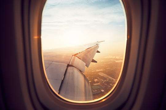 The view from a window of an airplane landing in Bangkok.