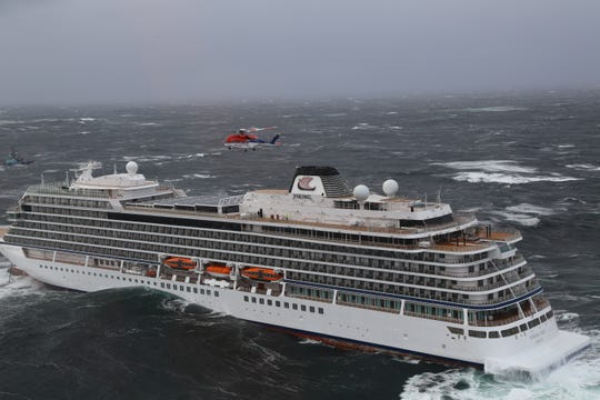 Rune Jansen, a crewman from helicopter service CHC in Norway, spent 10 hours on the deck of the Viking Sky hoisting up passengers into a helicopter.
