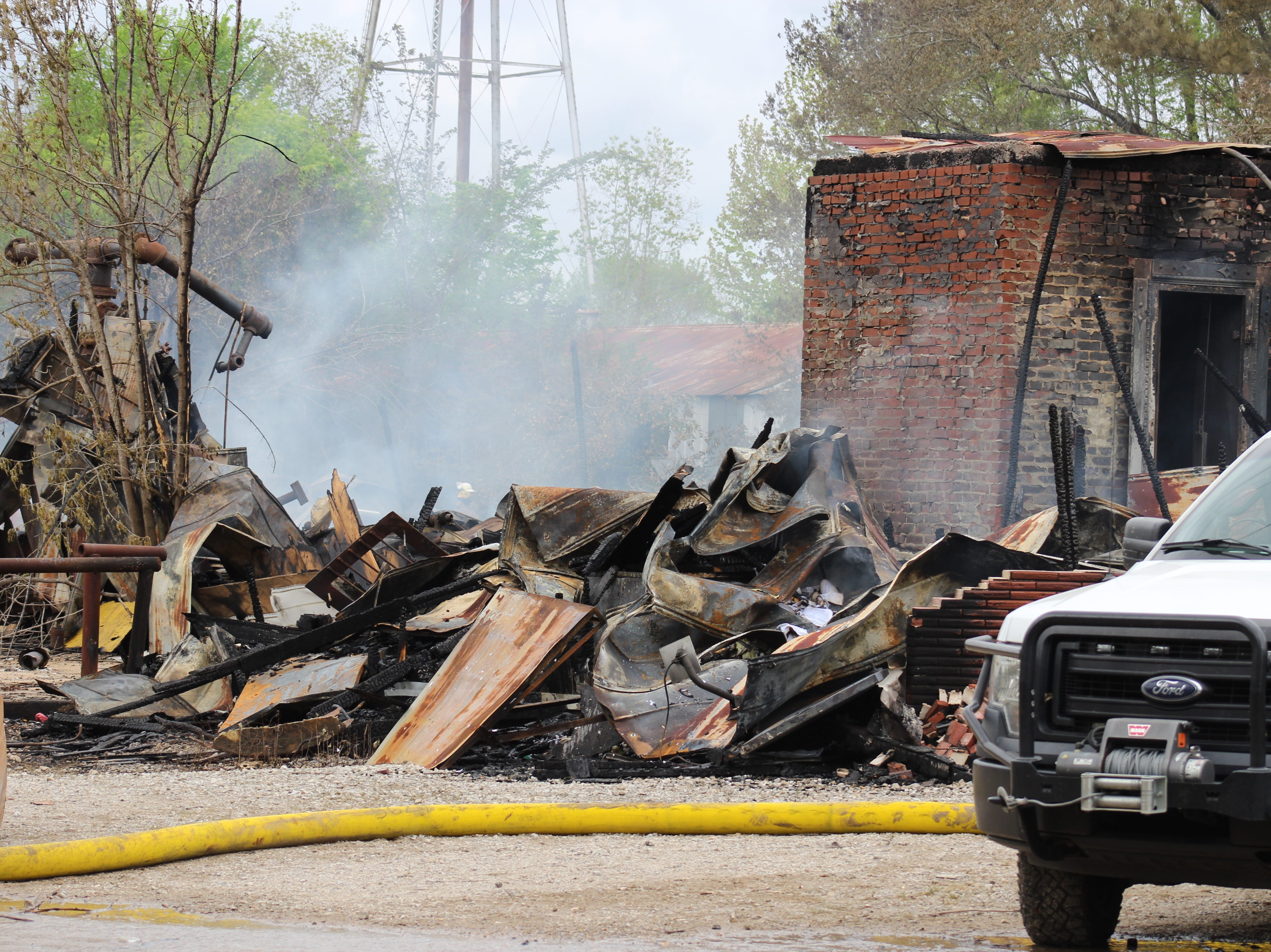 On Friday (March 29, 2019), Alexandria Fire Department and city of Alexandria crews remained at the site of the Alexandria Iron & Supply fire. The business at the corner of 5th and Arial streets was a total loss. An investigation is continuing.