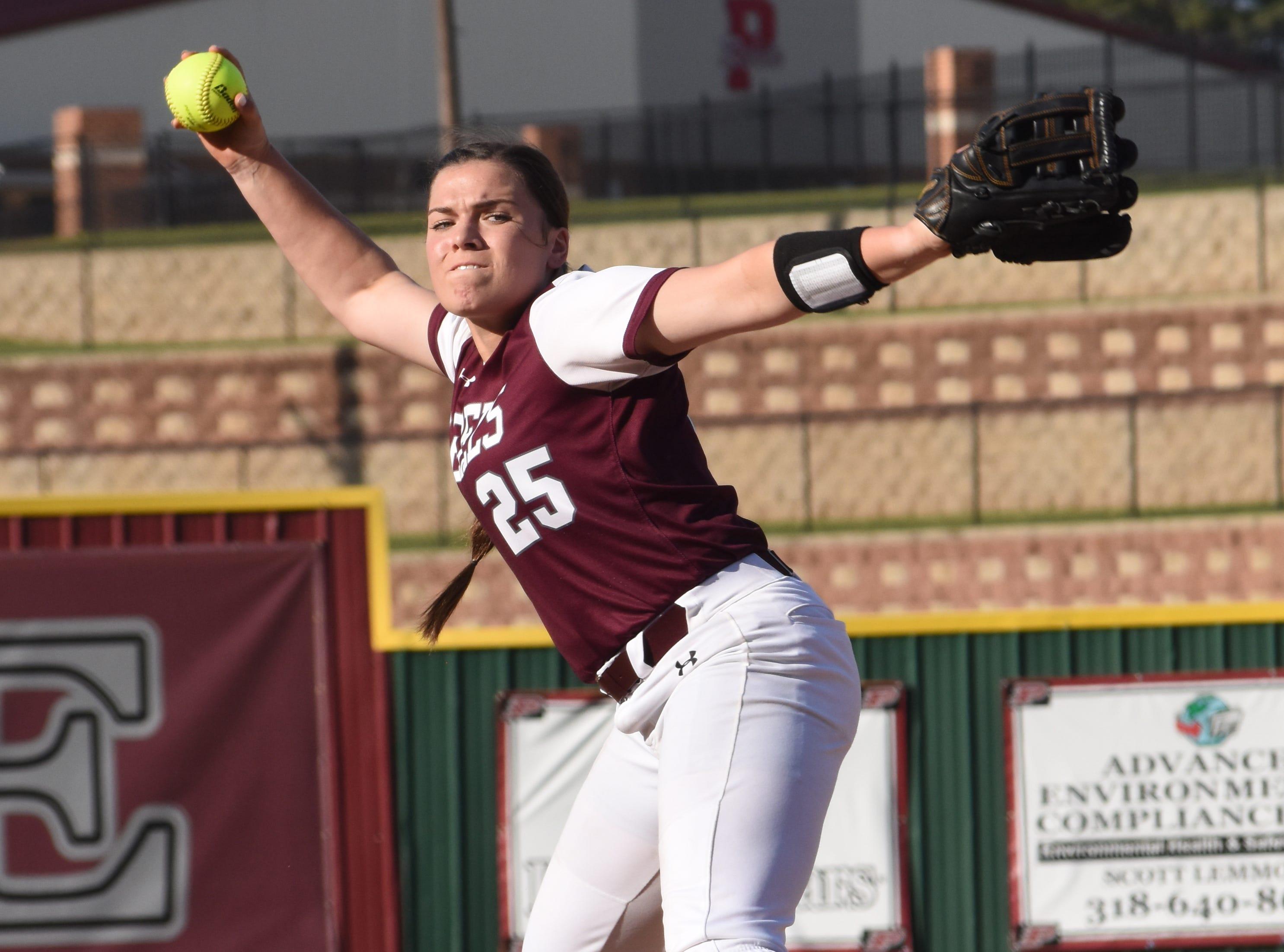Pineville's Alexis Garoutte (25) fires a pitch against West Monroe High School Lady Rebels Thursday, March 28, 2019. West Monroe won 11-2.