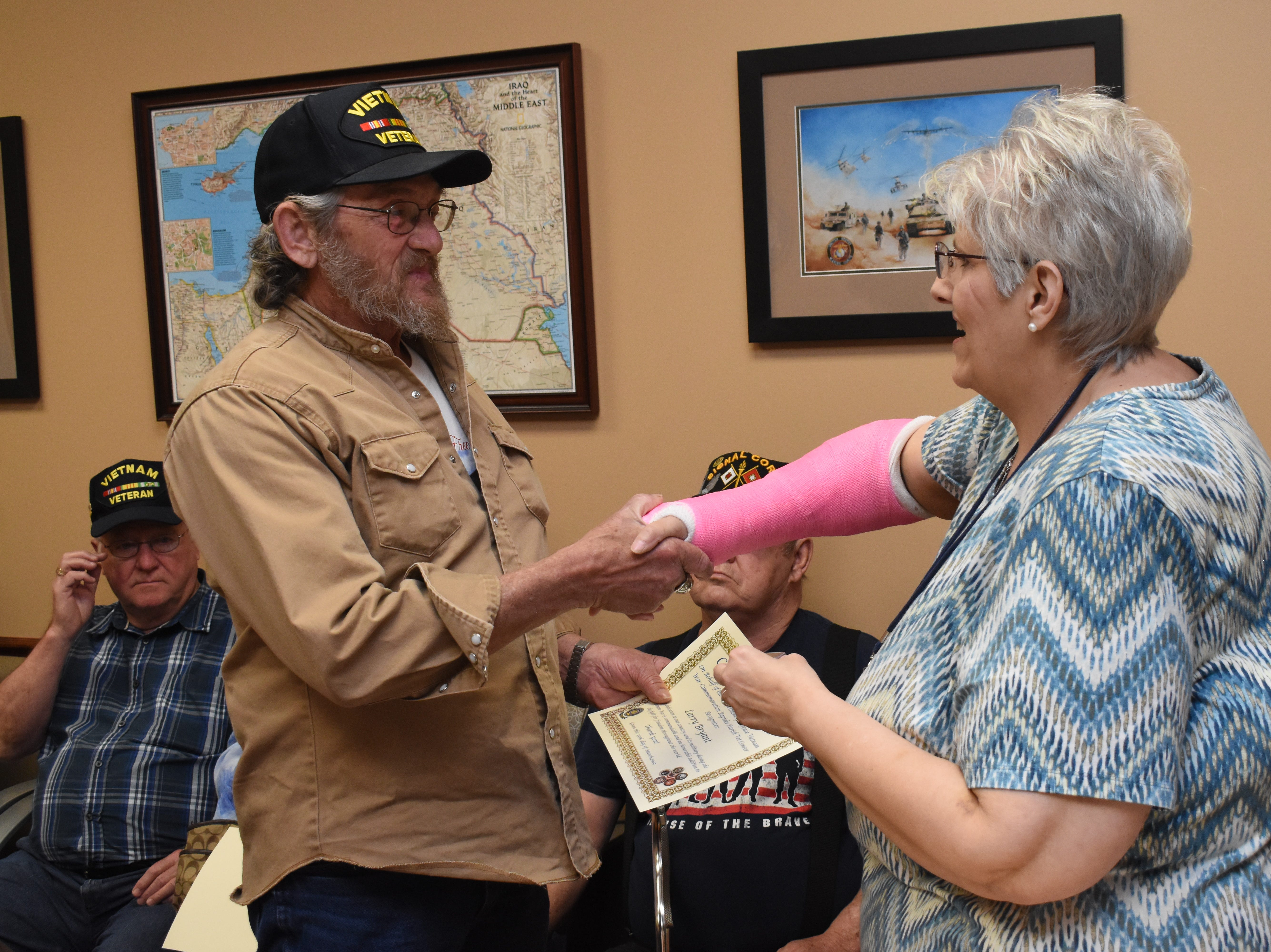 """Elizabeth Cheryl Nolen (right) executive director of the Rapides Parish Vet Center, hands Larry Bryant, a Vietnam War veteran, a certificate and pin in honor of his service during the Vietnam War. The Rapides Parish Vet Center, located at 5803 Coliseum Blvd., which serves combat-era military veterans, held a pin ceremony Friday, March 29, 2019 for Vietnam War veterans in recognition of Vietnam Veterans Day. Over the course of the day over 50 pins and certificates were handed out. Vietnam Veterans Day honors those who served and their families. The Vietnam War Veterans Recognition Act  was signed into law in 2017. """"Welcome Home Vietnam Veterans Day"""" is celebrated in most states on March 29 or March 30. On March 29, 1973 the last troops withdrew from Vietnam and American prisoners of war were returned. This is also the date President Richard Nixon designated for the first Vietnam Veterans Day in 1974. For more information about the Rapides Parish Vet Center and their services, call (318) 466-4327."""