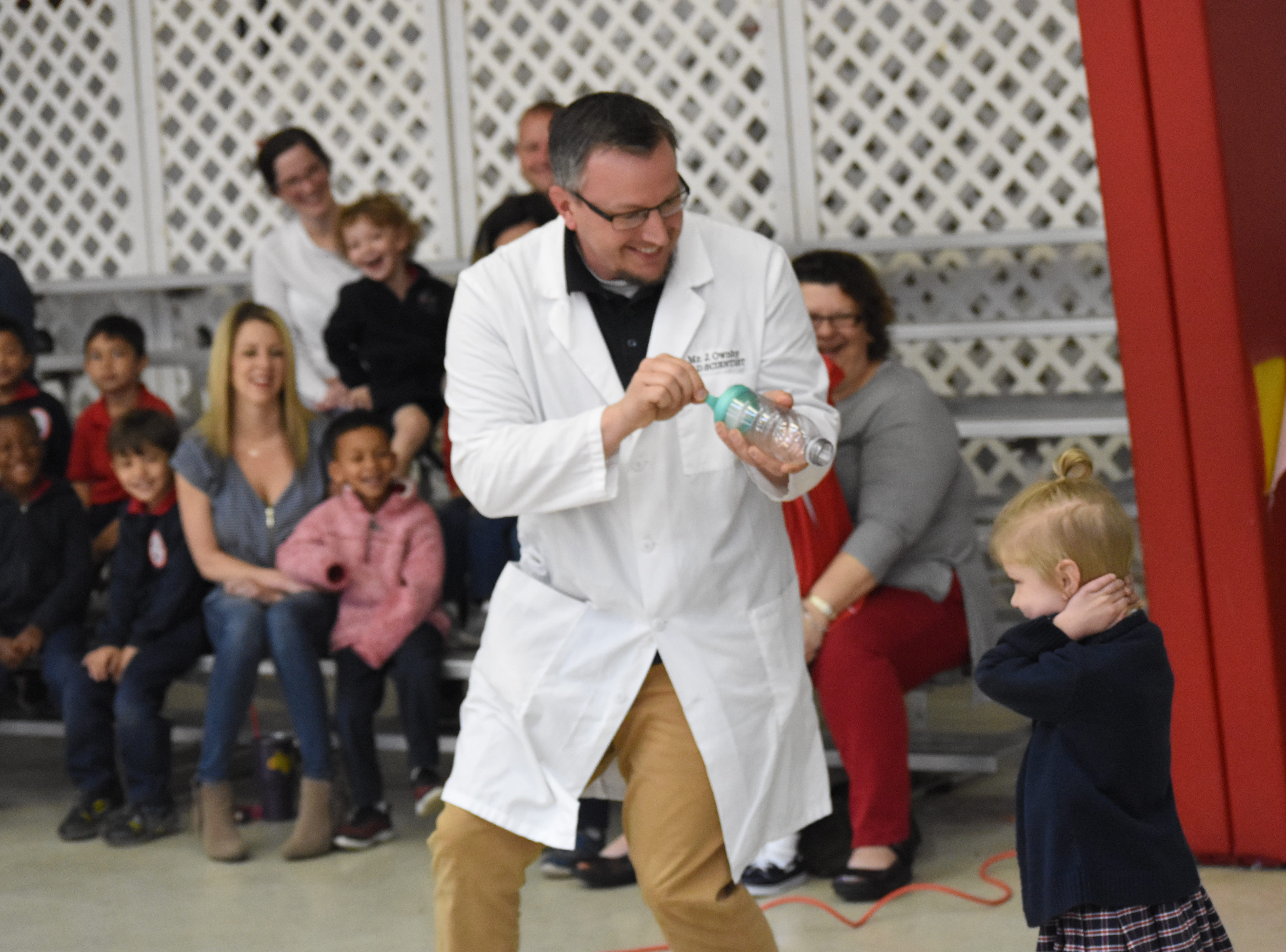 Jonathon Ownby of the Cyber Innovation Center based in Bossier City, conducts experiments using air and everyday objects for pre-Kindergarten and Kindergarten students at St. Frances Cabrini School. The experiments ere part of the National Integrated Cyber Education Research Center's STEAM Day which offers interactive presentations for students to see how objects around them can be used for science. The NICER offered three presentations at the school for all the students.
