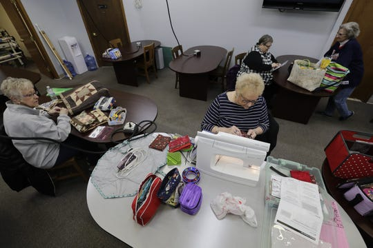 A group of customers work on their quilts in the classroom area of Fox Cities Quilt Co. in Appleton.