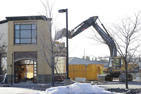 On Monday, the last of the former Parma restaurant in Grand Chute was taken down by Tom Van Handel Corp. backhoes.