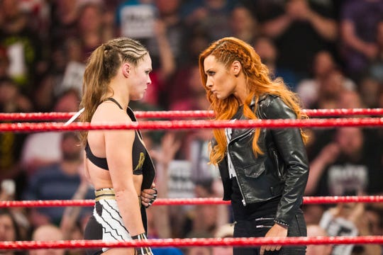 WWE superstars Ronda Rousey, left, and Becky Lynch will face Charlotte Flair at WrestleMania 35 in East Rutherford.