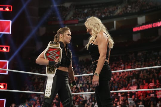 WWE superstars Ronda Rousey, left, and Charlotte Flair will face off with Becky Lynch at WrestleMania 35 in East Rutherford.