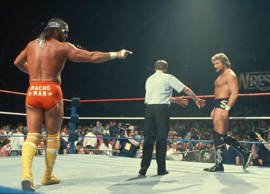 """Macho Man"" Randy Savage, left, and ""The Million Dollar Man"" Ted DiBiase at WrestleMania IV in Atlantic City, 1988."