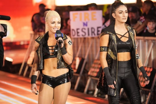 Shamong native Sonya Deville, right, pictured with WWE partner Mandy Rose.