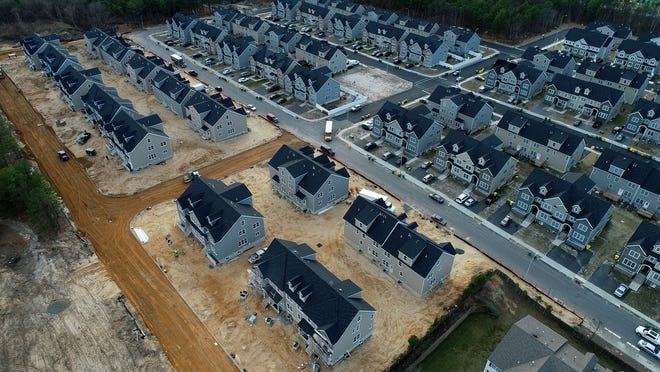 Construction continues for homes along Prospect Avenue in Lakewood Thursday, January 3, 2019.