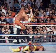"""Randy """"Macho Man"""" Savage hits his flying elbow drop on Hulk Hogan at WrestleMania V in 1989."""