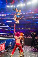 WWE superstar Charlotte Flair, in mid-flight.