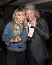 Miley Cyrus and Jon Bon Jovi attend the Hampton Water Rosé Celebrates LA on March 28, 2019 in West Hollywood, California.