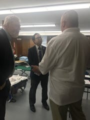U.S. Rep. Andy Kim meets with Bill Southrey (l) and Paul Hulse (r) of Haven Beat the Street at Riverwood Park Code Blue facility in Toms River.