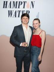 Jesse Bongiovi and Dakota Fanning attend the Hampton Water Rosé Celebrates LA on March 28, 2019 in West Hollywood, California.