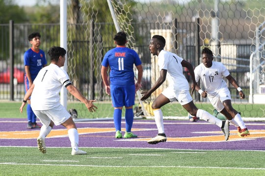 Abilene High's Enock Gasore (9) celebrates scoring the first goal against Arlington Bowie in a Region I-6A bi-district playoff at Granbury's Pirate Stadium on Thursday, March 28, 2019.