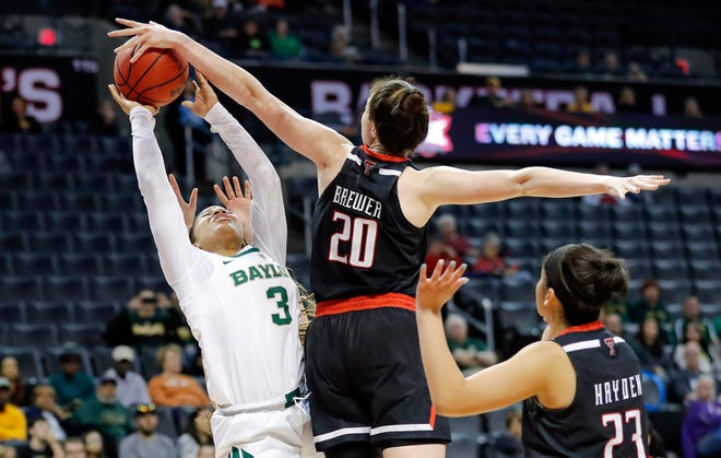 Texas Tech forward Brittany Brewer (20) blocks a shot by Baylor guard Trinity Oliver (3) during the second half in the Big 12 women's conference tournament in Oklahoma City, Saturday, March 9, 2019. Baylor won 100-61. (AP Photo/Alonzo Adams)