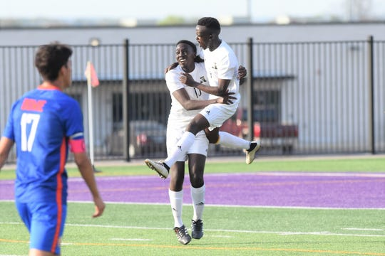 Abilene High's Enock Gasore (9) jumps into the arms of Joshua Musonera (10) after scoring the opening goal against Arlington Bowie in a Region I-6A bi-district playoff at Granbury's Pirate Stadium on Thursday, March 28, 2019.