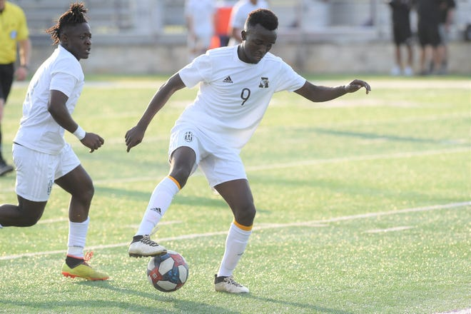 Abilene High's Enock Gasore (9) settles the ball during the Region I-6A bi-district playoff against Arlington Bowie at Granbury's Pirate Stadium on Thursday, March 28, 2019. Gasore scored the first Eagles goal in the 4-2 loss.