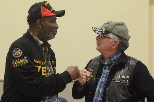Bobby Johnson, left, and Mike Mooney, both served in Vietnam before long careers with the Battle Creek Public Schools. They shared some stories Friday.