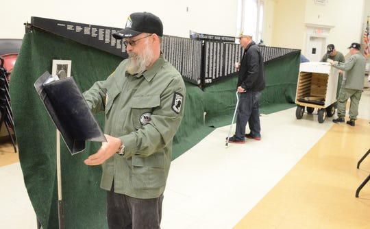 Charles Troost of Holland helps prepare the Vietnam War Traveling Wall Friday at the Veterans Affairs Medical Center.