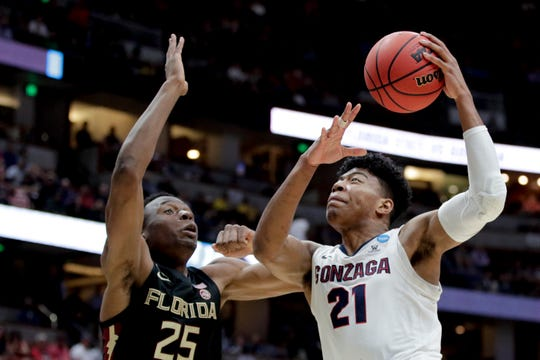 Gonzaga forward Rui Hachimura, right, shoots over Florida State forward Mfiondu Kabengele during the first half an NCAA men's college basketball tournament West Region semifinal Thursday, March 28, 2019, in Anaheim, Calif.