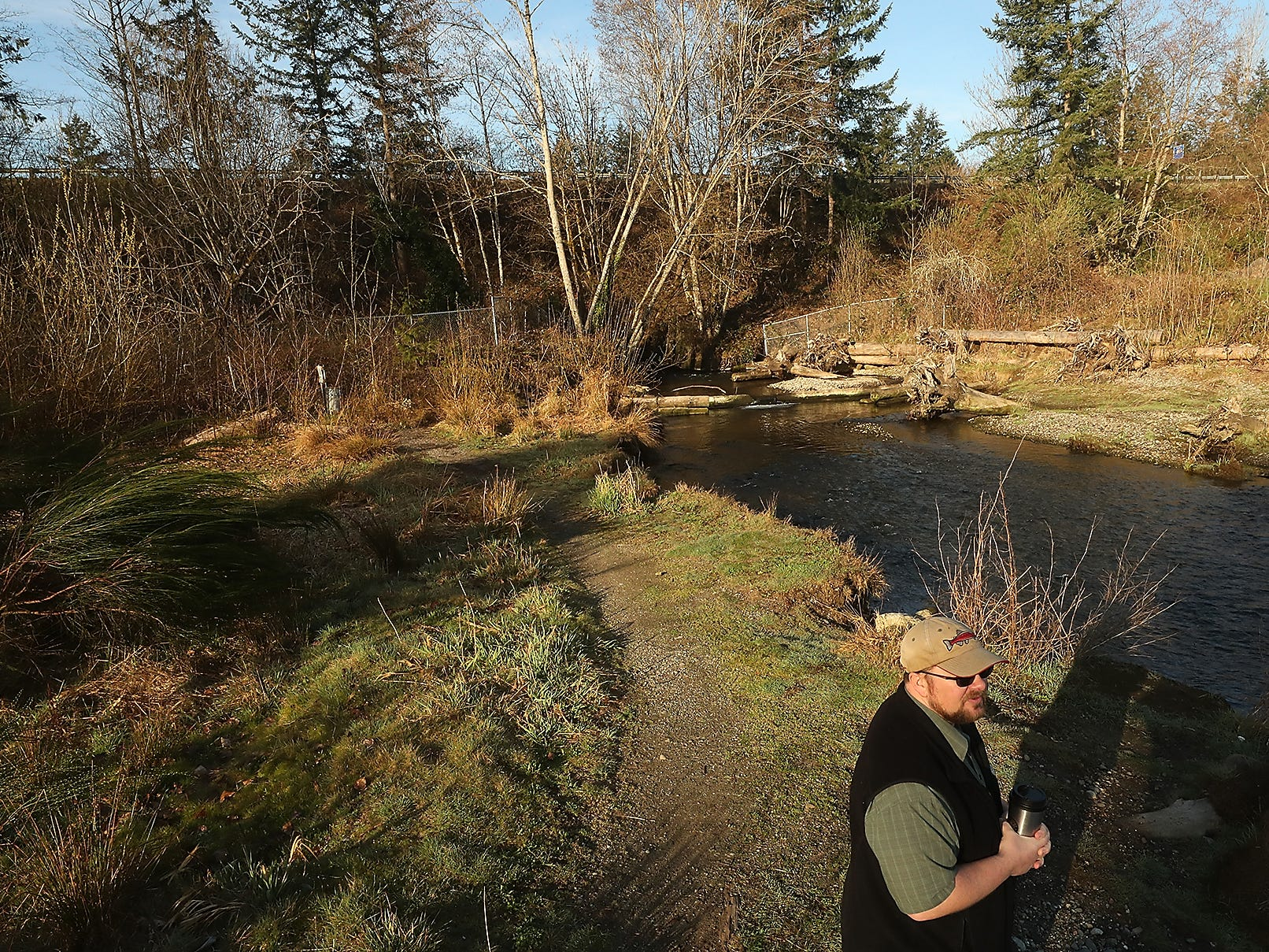 Washington Department of Fish and Wildlife's Chris Waldbillig stands along the mouth of Chico Creek as he talks about the proposed bridge project on Friday, March 29, 2019.