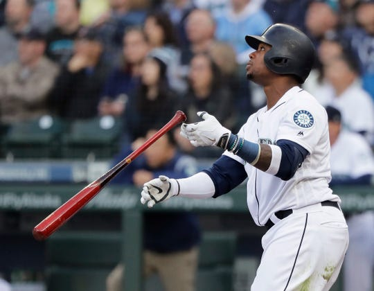 Seattle Mariners' Tim Beckham watches his two-run home run against the Boston Red Sox during the third inning of a baseball game Thursday, March 28, 2019, in Seattle. The homer was Beckham's second of the day.