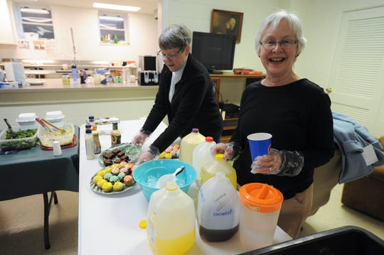 Ginny Soll, right, and Diane Ginther, members of Black Mountain Presbyterian Church, are two of five volunteers from the church to prepare and serve dinner, on March 27, for the Swannanoa Valley Christian Ministry homeless shelter that operates during the winter months in the fellowship hall at First Baptist Church of Black Mountain.
