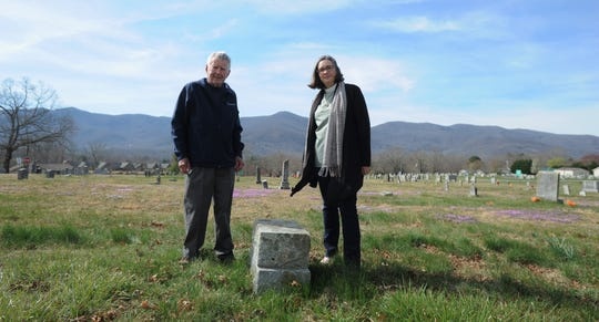Robert Goodson and Tabernacle United Methodist Church pastor Lisa Beth White stand near a stone in the cemetery that marks the original location of the church. Just feet away is the final resting place of Coleman Stepp, who the church will honor by unveiling a headstone in a ceremony on April 14.