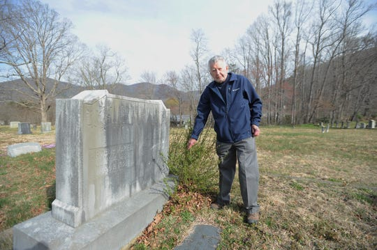 Robert Goodson clears away a small bush in front of the headstone marking the grave of Cora Doula McKee, the granddaughter of Jesse Stepp, who rests just feet away from the grave of Coleman Stepp at the Tabernacle United Methodist Church Cemetery.