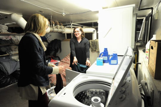 Robin Parish, right, and Lydia Piece are two of over 600 volunteers who have helped at the Swannanoa Valley Christian Ministry shelter this winter.