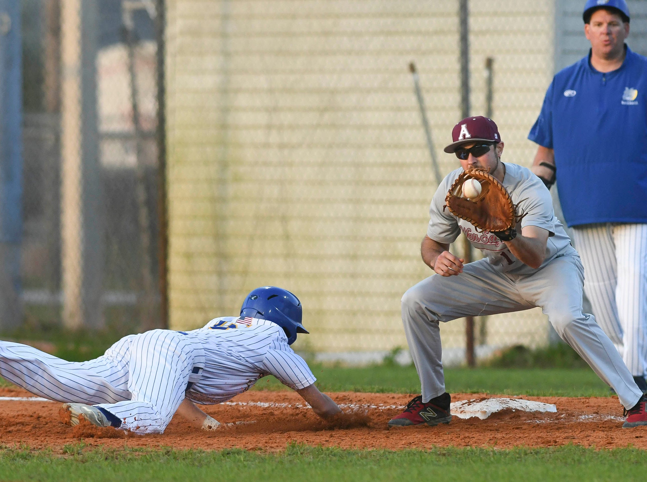 Astronaut first baseman Colton Gelinas tries to pick off Titusville base runner Dustin Monaco during Thursday's game in Titusville.