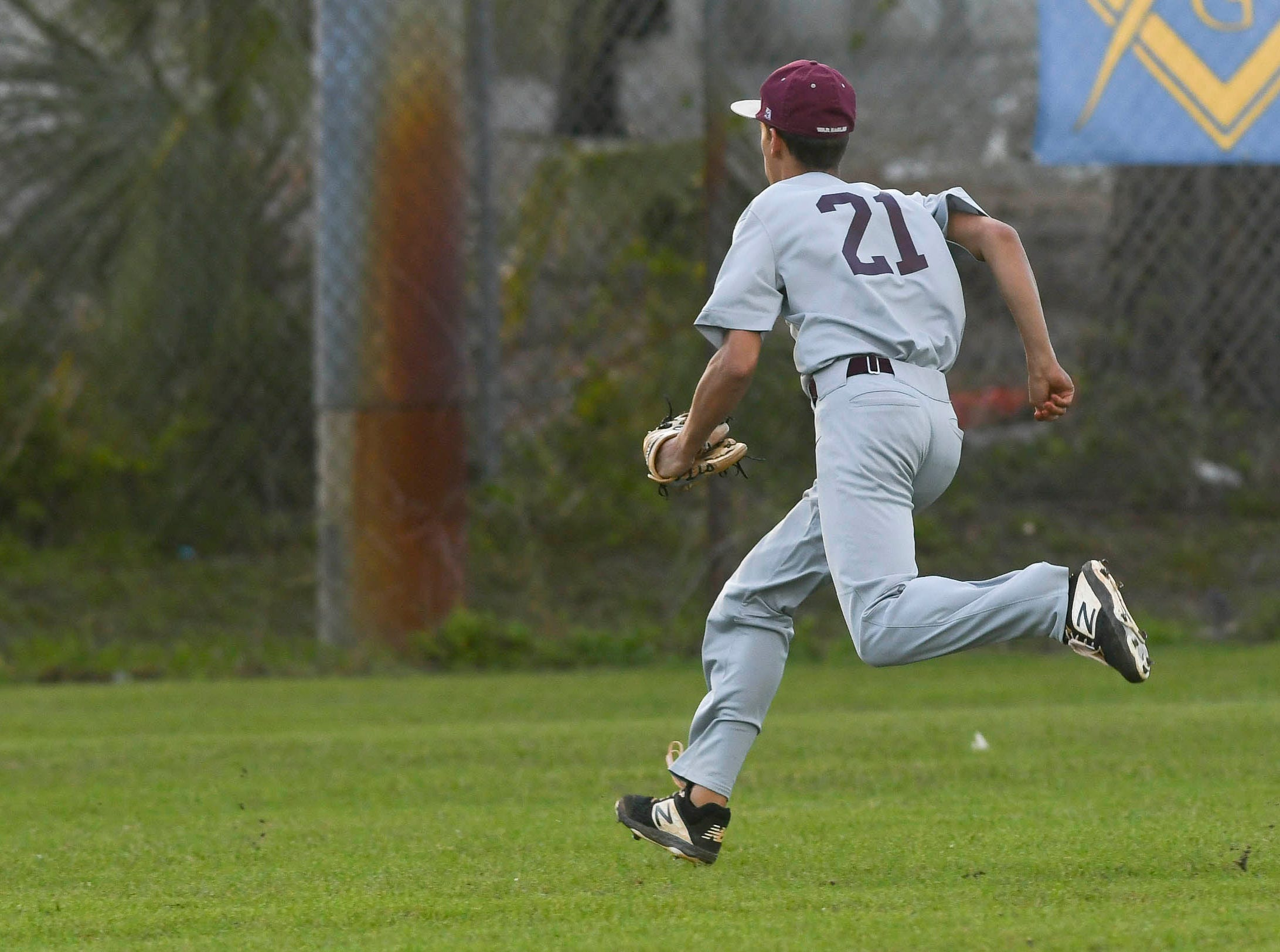 Austin Roberts of Astronaut chases a ball in the outfield during Thursday's game against  Titusville.