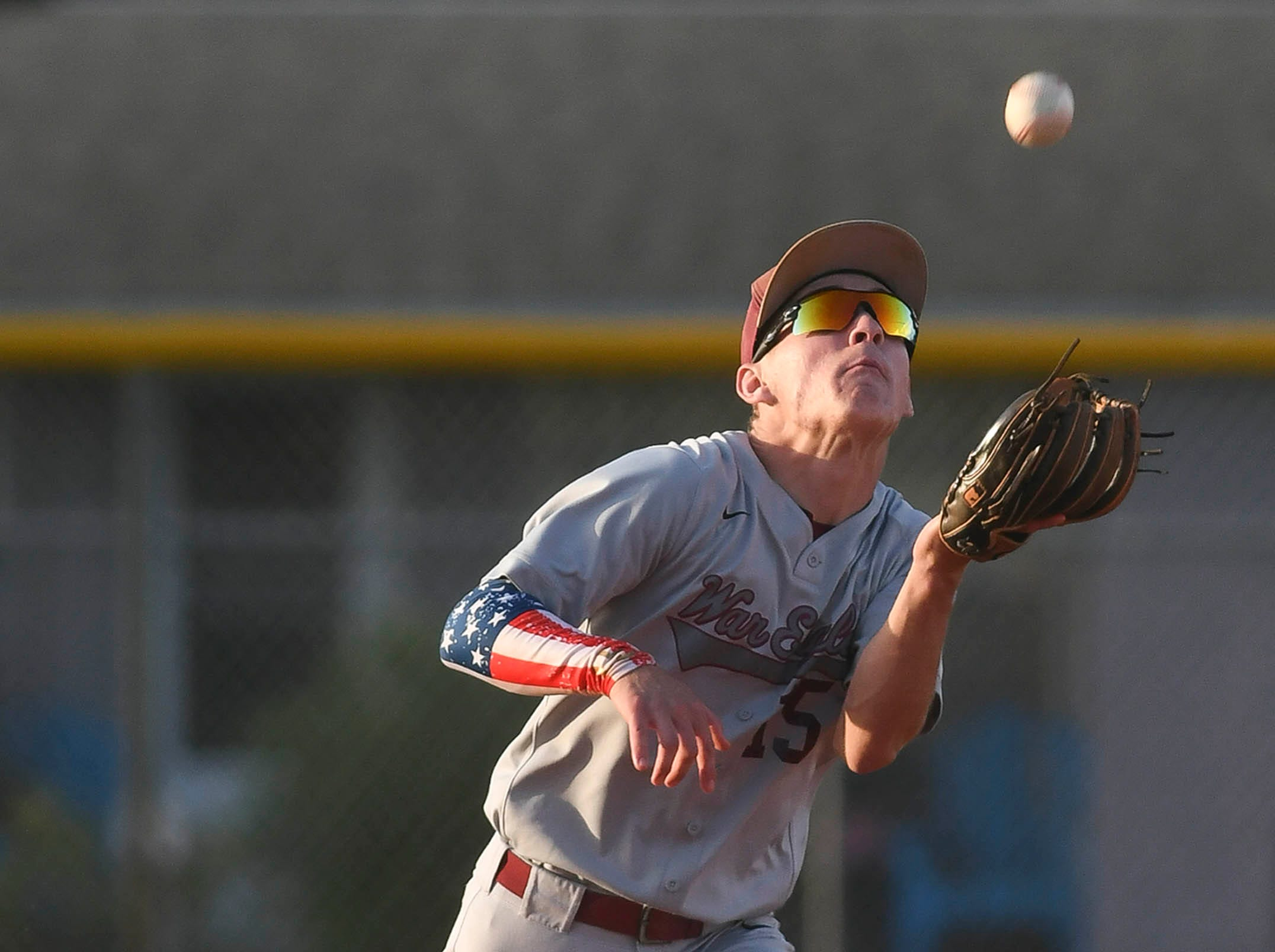 Max Simons of Astronaut chases down a fly ball during Thursday's game in Titusville.