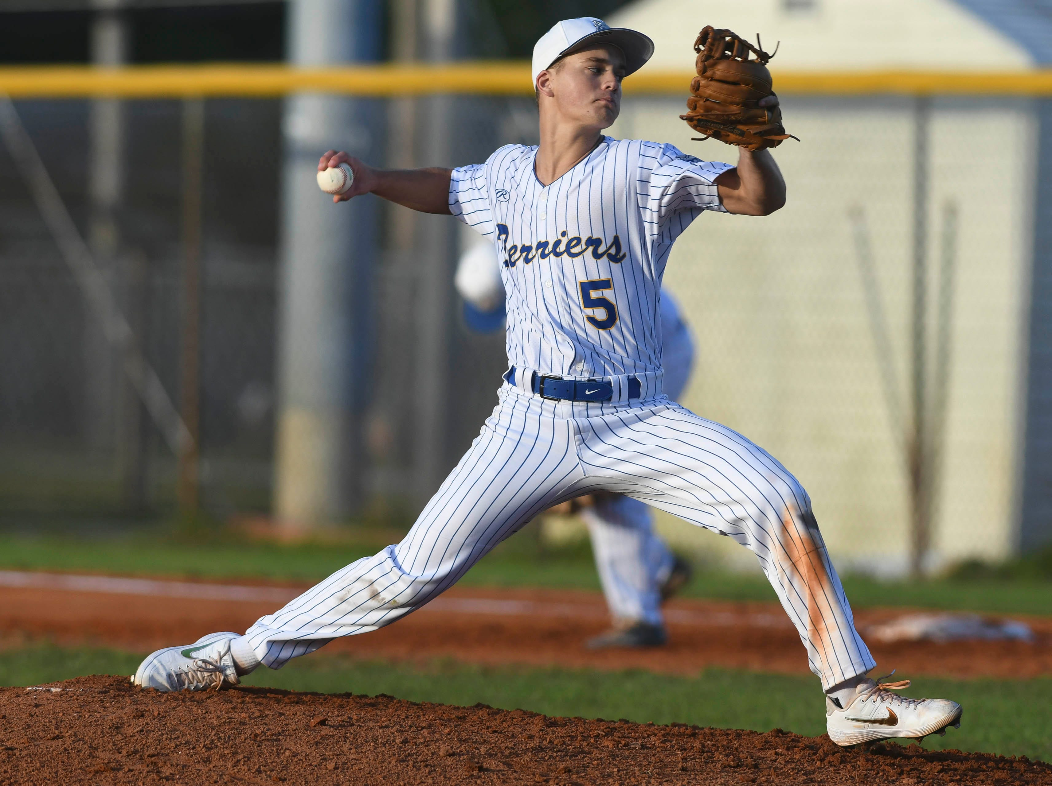 Jackson Woodward of Titusville throws out an Astronaut baserunner during Thursday's game.
