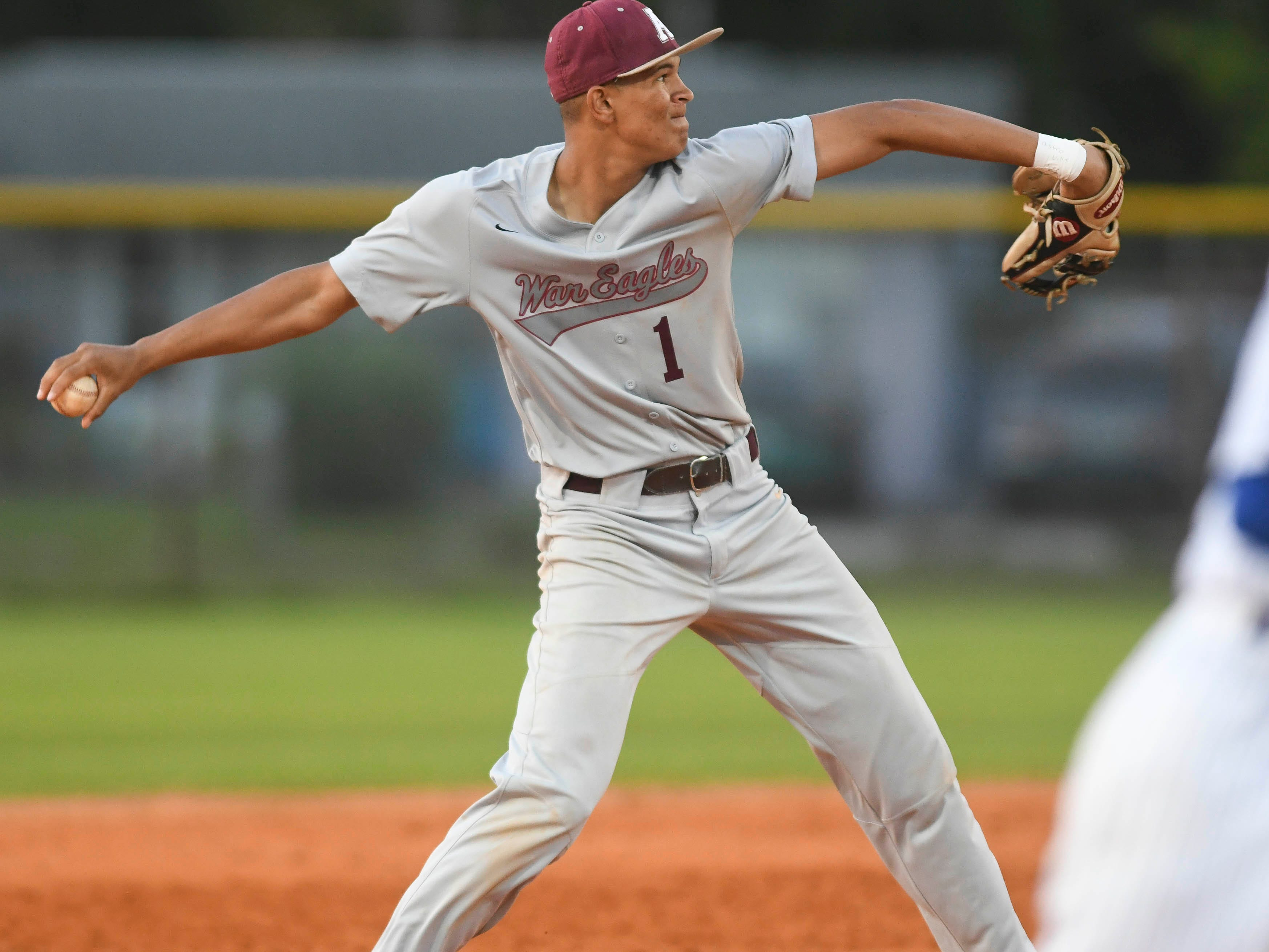 Daymon Wooodraff of Astronaut throws out a Titusville baserunner during Thursday's game.